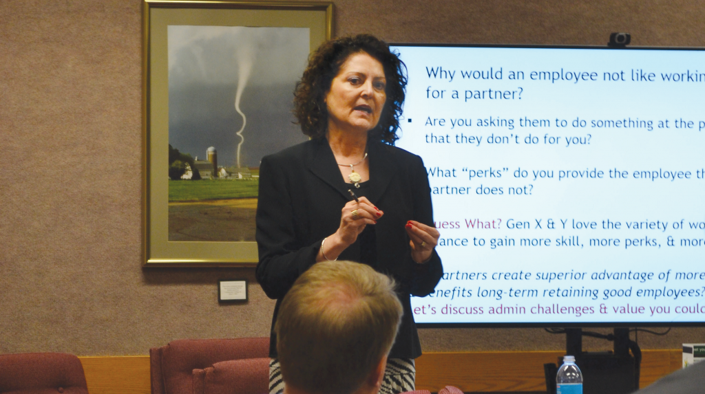 Donna Dau talks to a group of human resources professionals in Chariton.