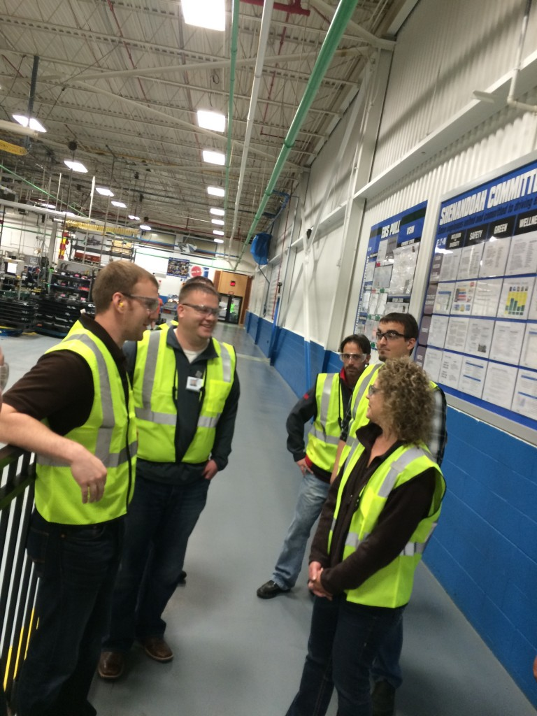 A group from Pella Windows toured Eaton Corp. and power management company and maker of electrical supplies in Urbandale.