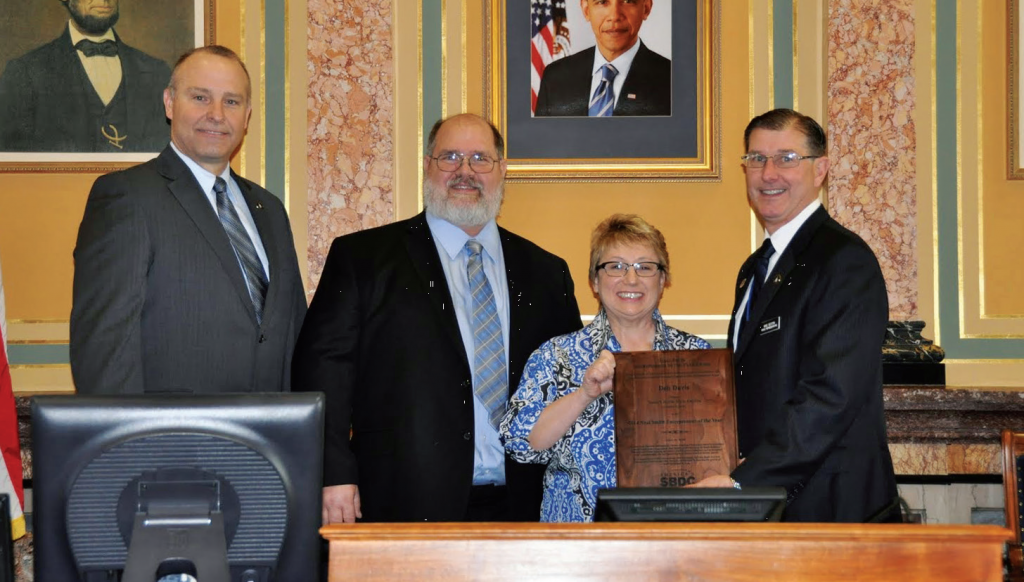 Deb Davis is honored at the Iowa Capitol earlier this year after being named Entrepreneur of the Year.