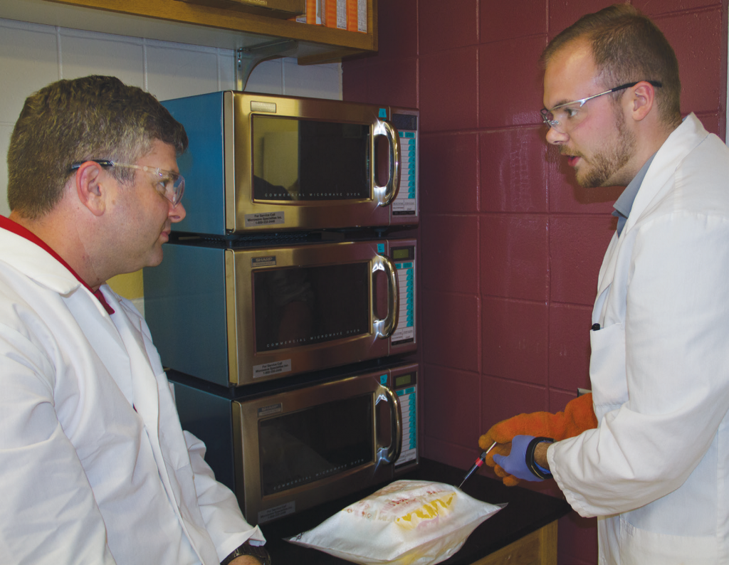 Keith Vorst and graduate student Nathan Davis evaluate the performance and safety of microwave popcorn