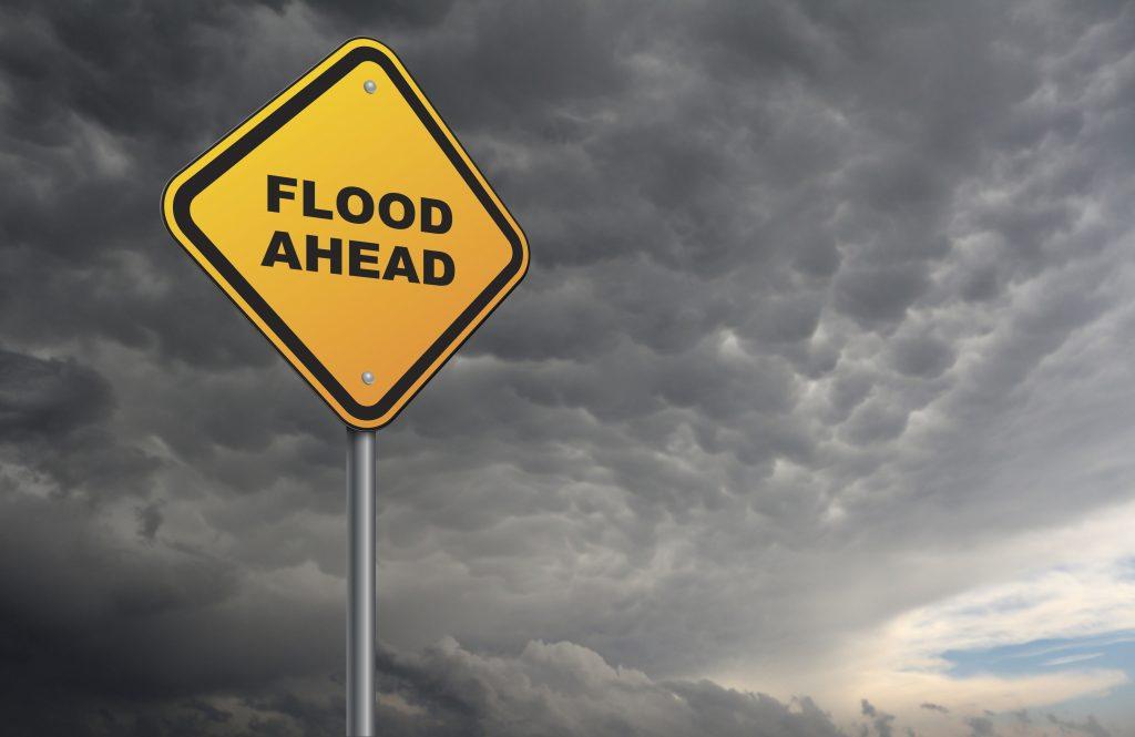 flood ahead of roadsign