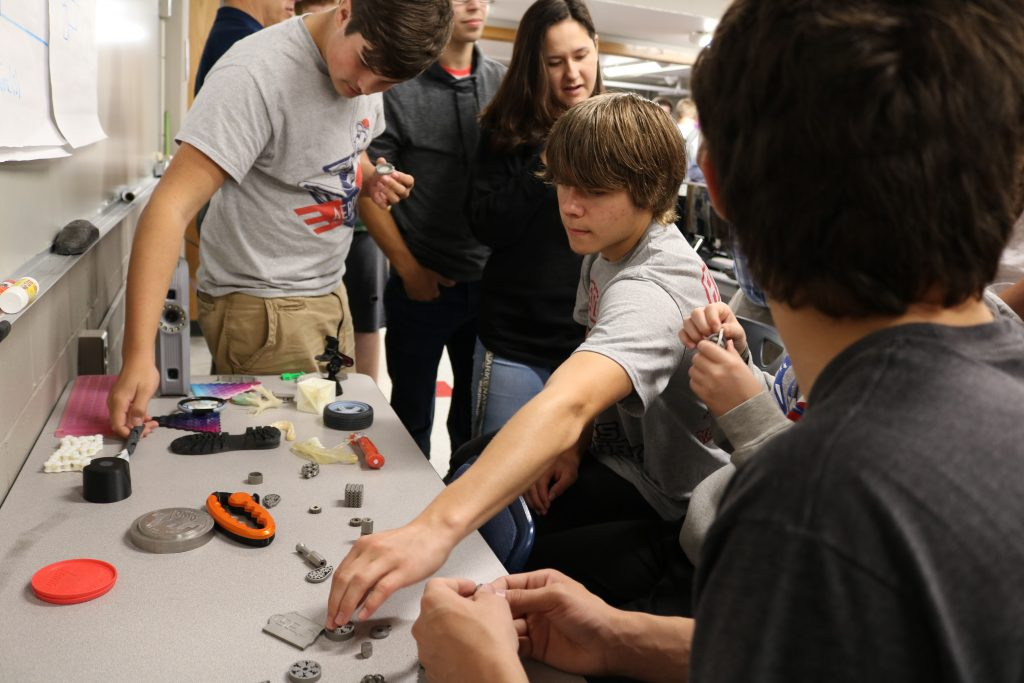 Boone High School students were allowed to get up close and personal with parts made from a metal 3D printer.