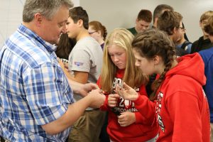 Boone High School students speak with CIRAS' Chris Hill about parts made with an Iowa State University metal 3D printer.
