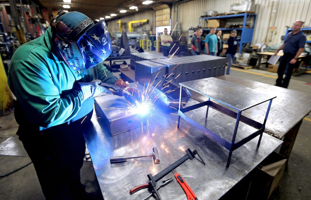Maquoketa High School students toured Precision Metal works earlier this month. (Dave Kettering, Dubuque Telegraph-Herald)