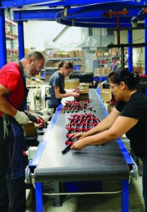 Double HH Manufacturing workers sort hitch pins.