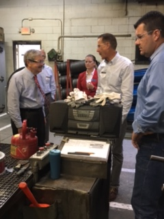 Gov. Terry Branstad toured Thrombert, a maker of polyurethane forklift tires and wheels in Newton.